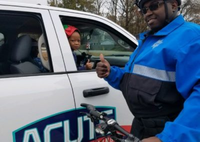 Parade Resource Officer On Bike With Little Girl Compressed For Blog